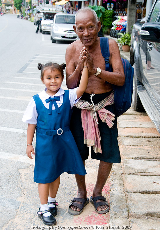 Girl and Old man at Karon Beach Phuket Thailand