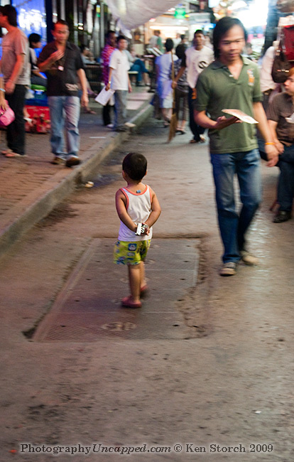 Boy with gun Patpong District Bangkok Thailand
