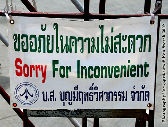 Sorry for Inconvenient - sign at Wat Trimit, Bangkok, Thailand