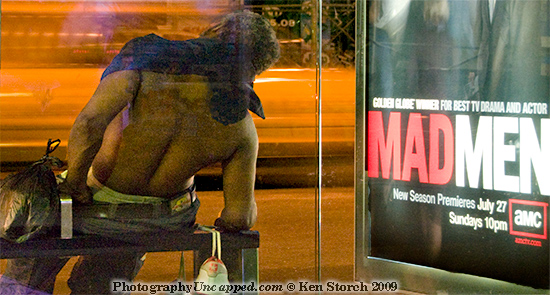 A close detail of the figure and Mad Men sign